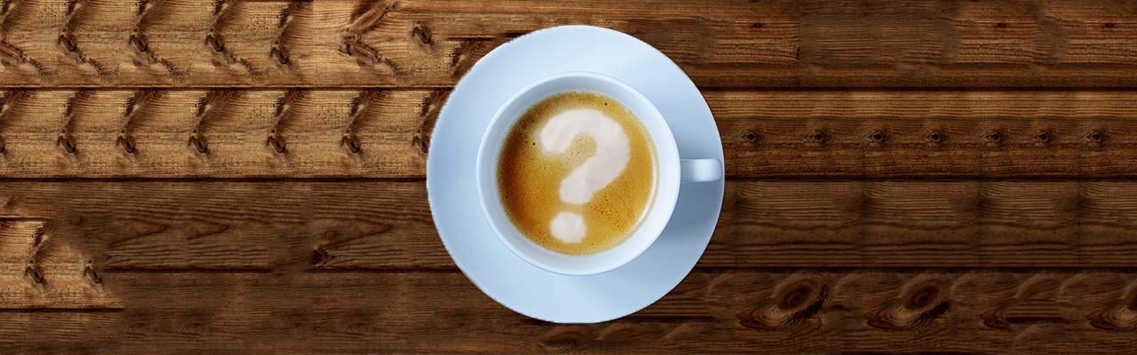 Coffee cup with question mark in the froth concept for problems,